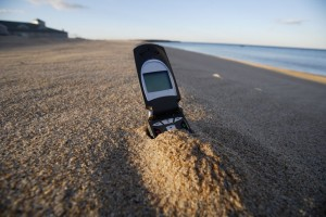 A74HT0 Cell phone in sand on Beach